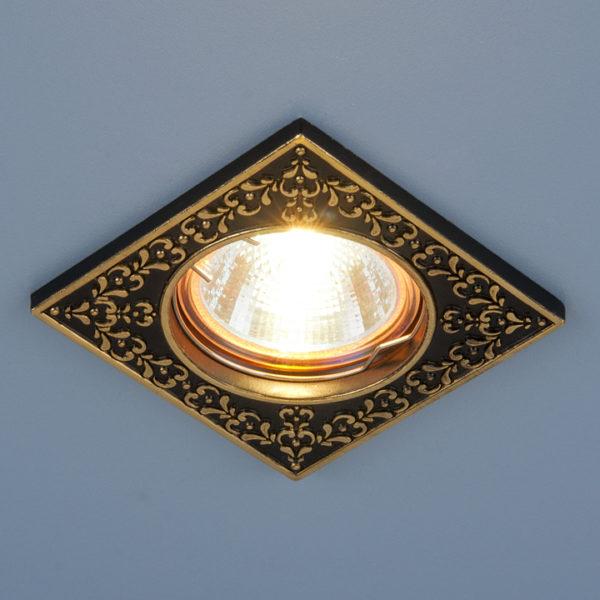 1b25512ca0cf822b8b10df61d9a11388 600x600 - встр. точечный светильник Elektrostandard 120071 черный/золото